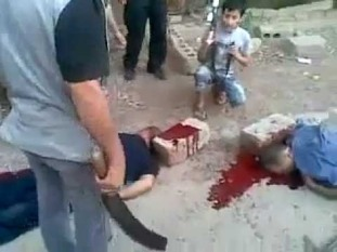 aUFuNHh6cG94ZUkx_o_fsa-terrorists-cuts-off-citizens-heads-in-syriafa-