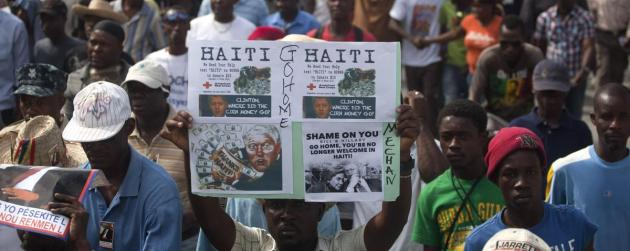 five-years-after-devastating-haiti-earthquake-protesters-want-president-martelly-to-step-down-1421091105